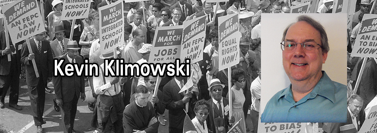 [Demonstrators marching in the street holding signs during the March on Washington, 1963] / MST. Wikimedia Commons