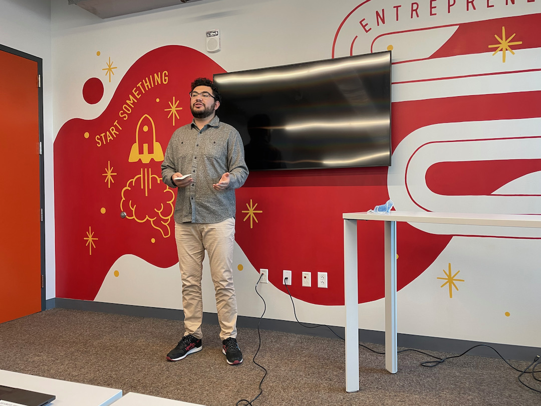 a student presents his ideas about entrepreneurship and innovation