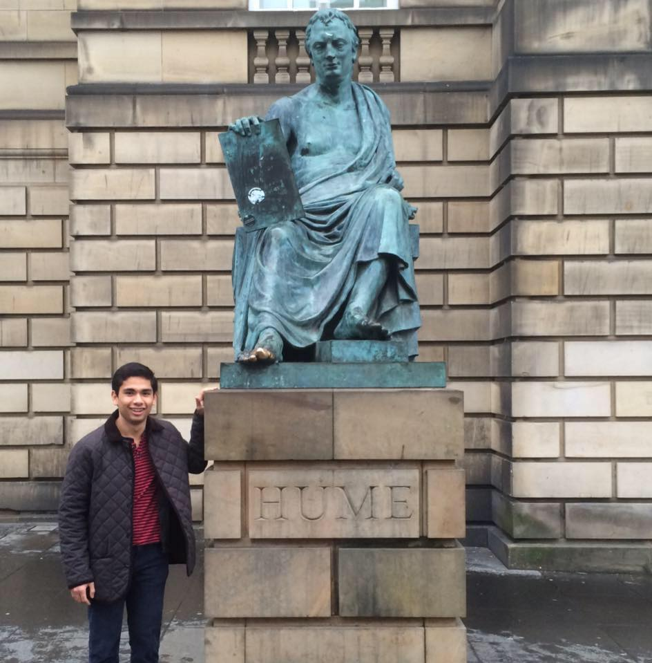 Brian Garrido poses with a sculpture of David Hume, a Scottish philosopher