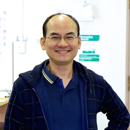 Edward Yu standing in his lab.