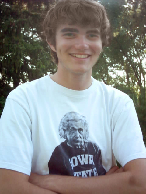 Rob Stupka outside, wearing a t-shirt with Albert Einstein wearing Iowa State gear.