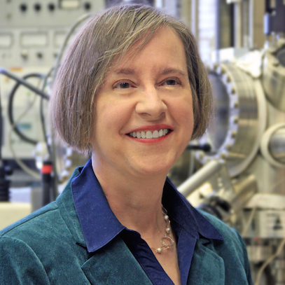 A portrait style photo of Patricia Thiel in front of lab equipment.