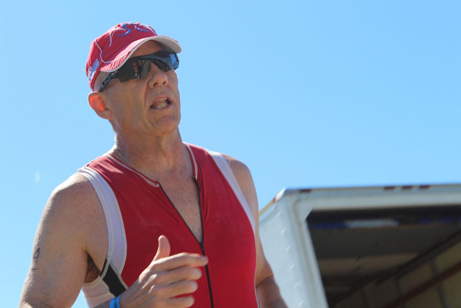 Captain Ricks Polk running with a clear blue sky behind him.