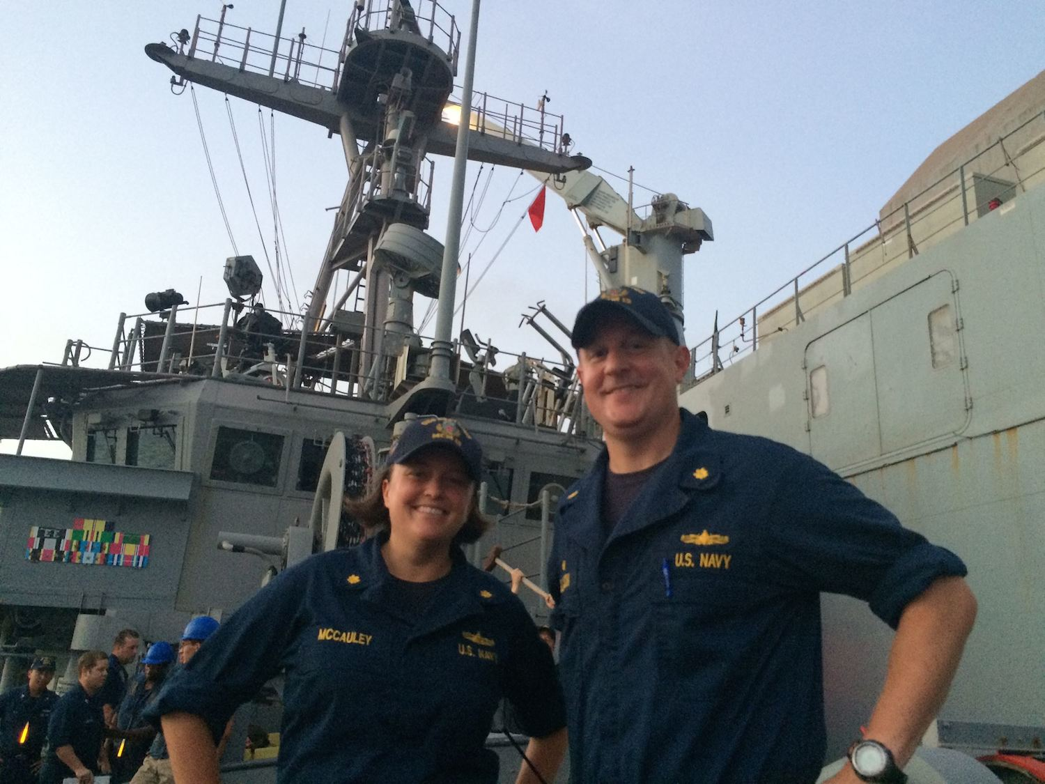 Lt. Cmdr Matt Gleason and his executive officer pose on a ship.