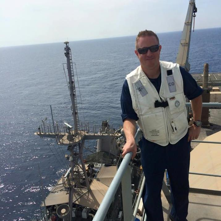 Lt. Cmdr. Gleason overlooks his ship from the Royal Fleet Auxiliary Cardigan Bay, while receiving fuel.