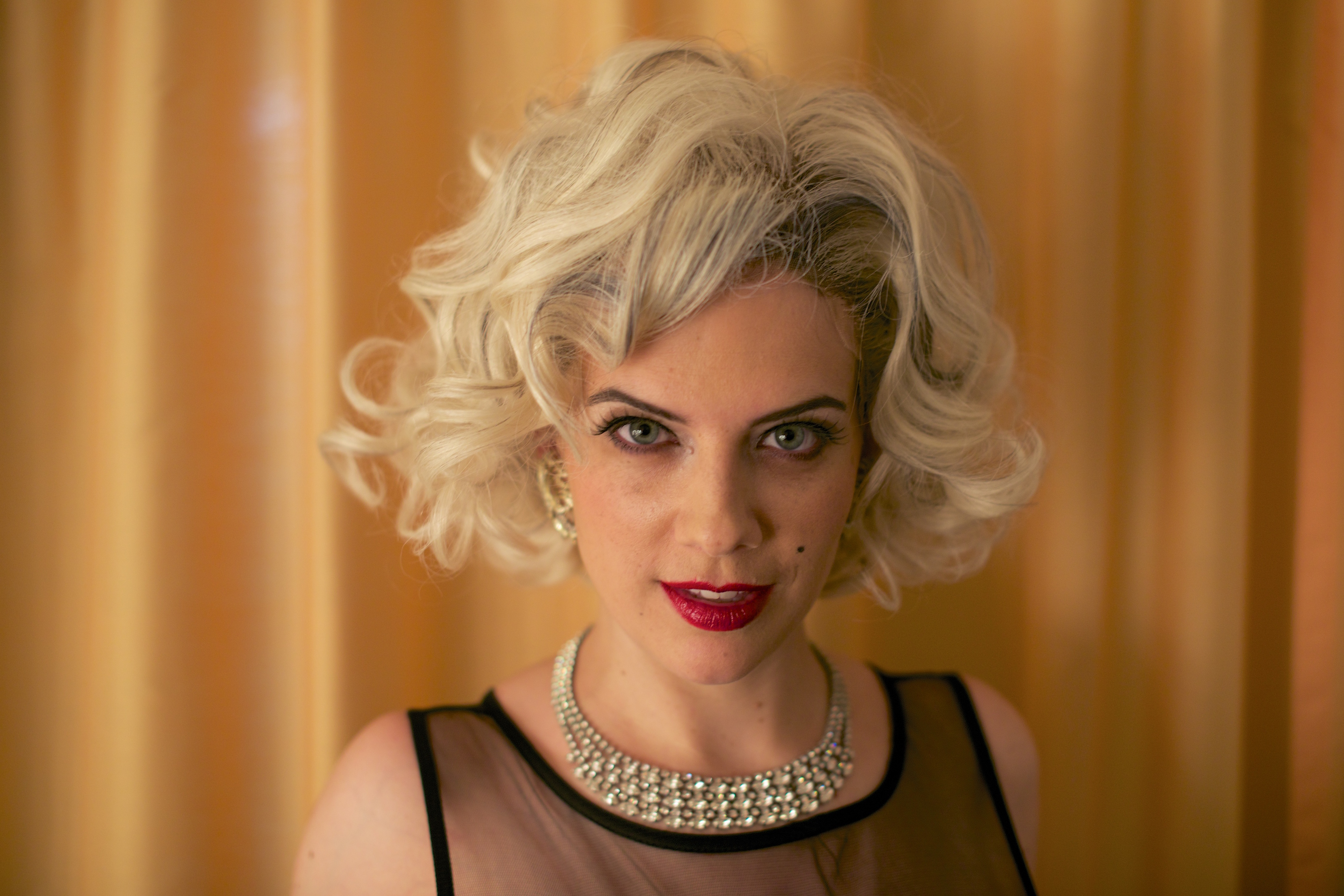 Portrait style photo of Jennifer Porto dressed as Marilyn Monroe.