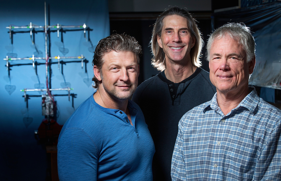Curtis Mosher (left), Eric Henderson (middle) and Mike Mcloskey (right) have assembled a prototype biomimetic tree that produces electricity. Such technology could appeal to a niche market in the future, according to the researchers.