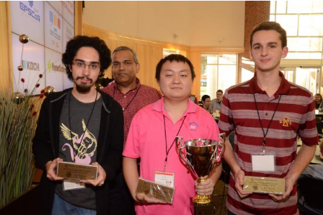 Three computer science students hold their trophies from a programming competition.