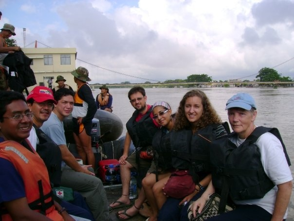 Kate Speckman on a boat with a group of volunteers wearing life jackets.