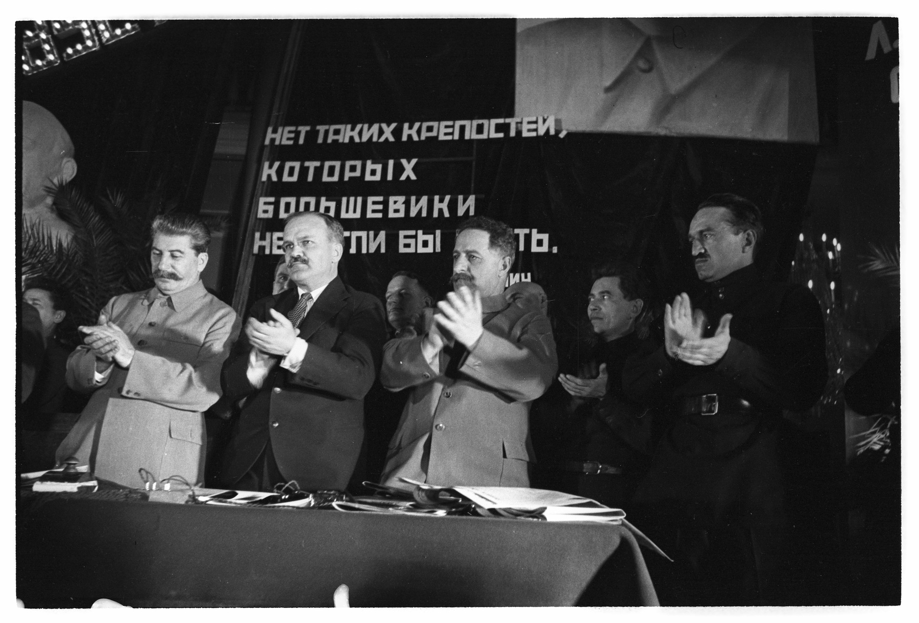 Joseph Stalin and a group of Soviet leaders celebrating the building of the first line of the metro.