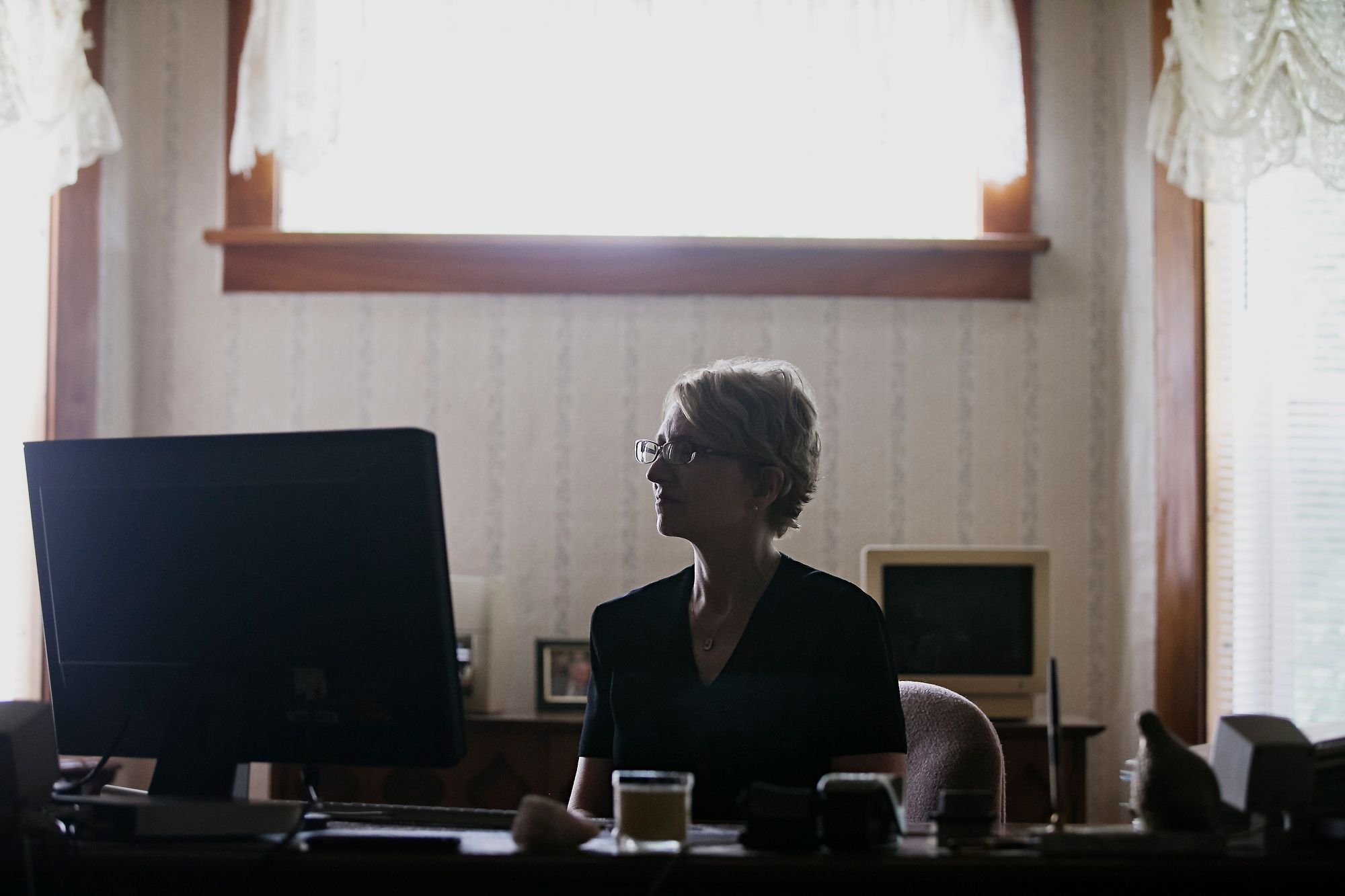 Jody Ewing in her home office. Ewing spends much of her day connecting with cold case victims