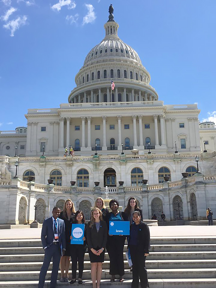 Students stand on the steps of the U.S. Capitol.