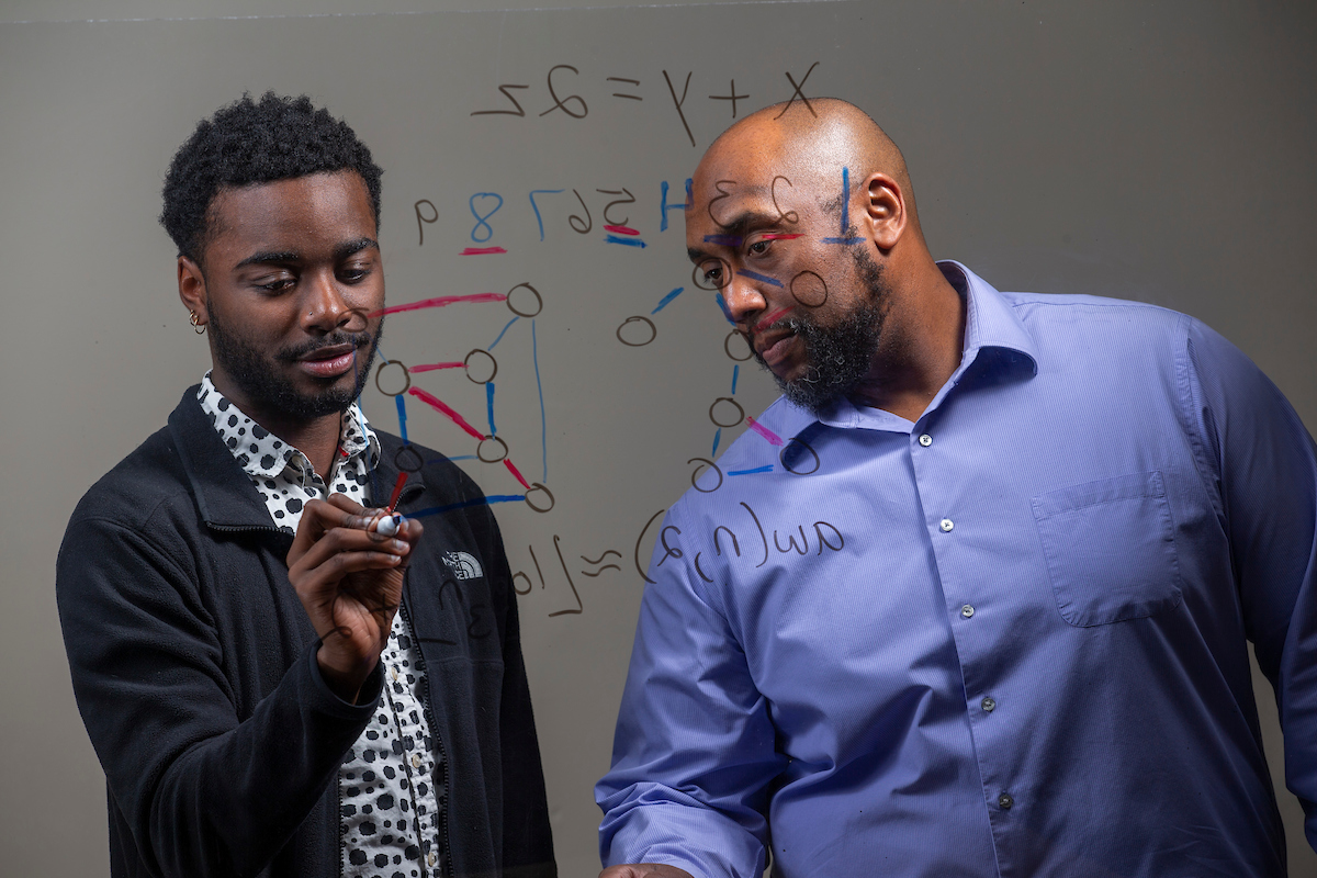 Professor and student calculate math answers
