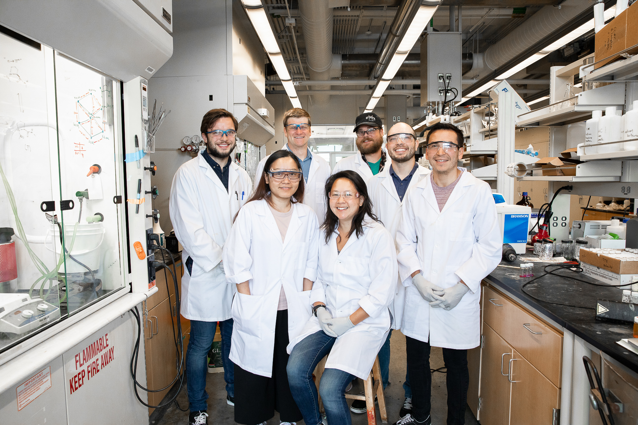 Dr. VanVeller and his team of research students pose in the lab