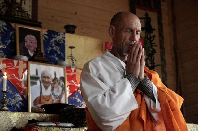 A monk prays intently in western Ukraine