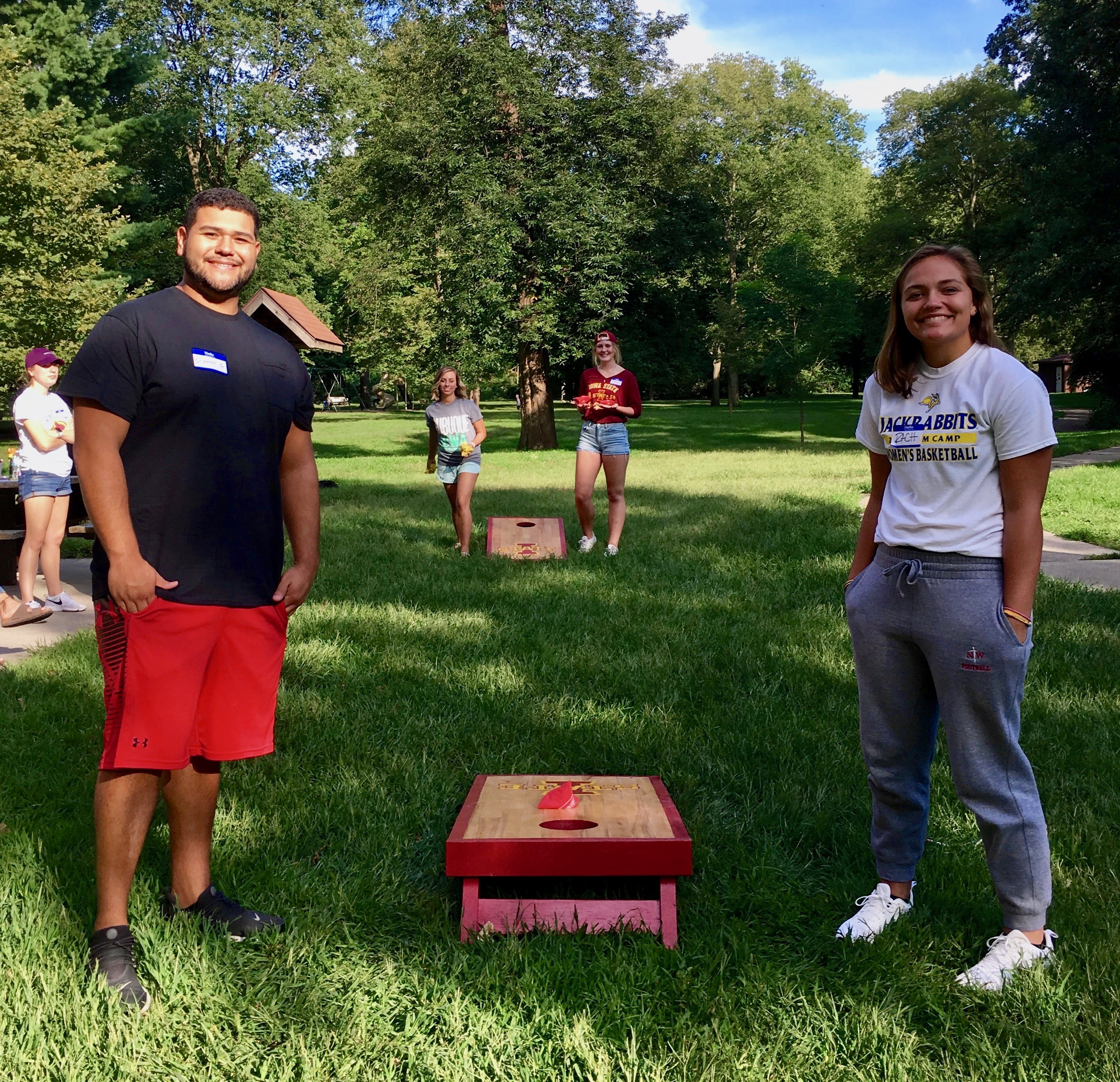 Students in the Psychology Freshmen Learning Community play a game of cornhole.