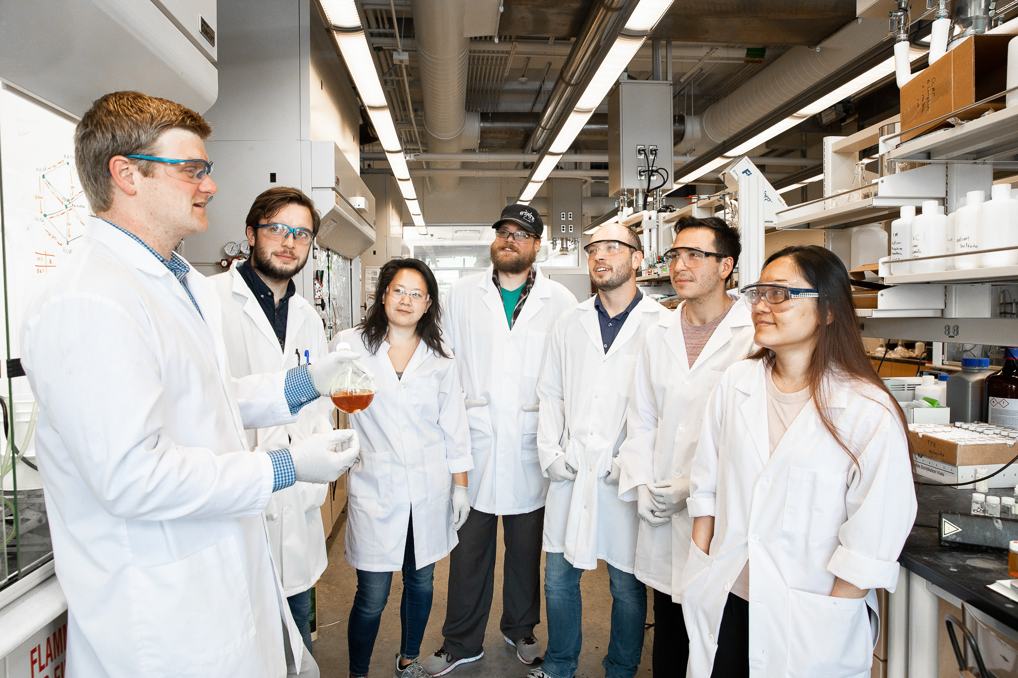 VanVeller and his team of student researchers discuss their research in the lab
