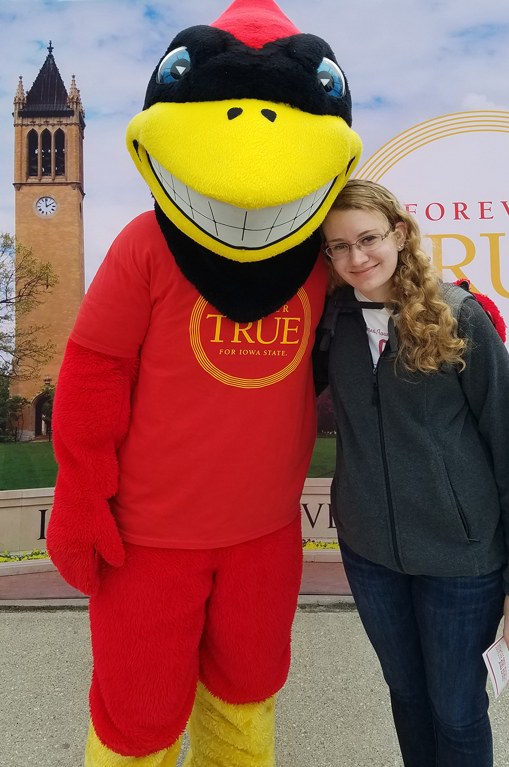 Student Sarah Zelle poses with mascot Cy