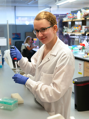 Student Sarah Zelle researches proteins in a lab