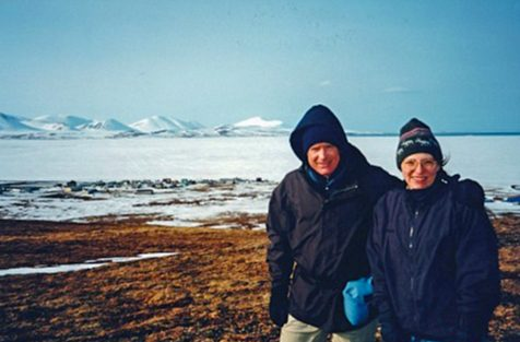 CDC scientist poses in an Alaskan landscape