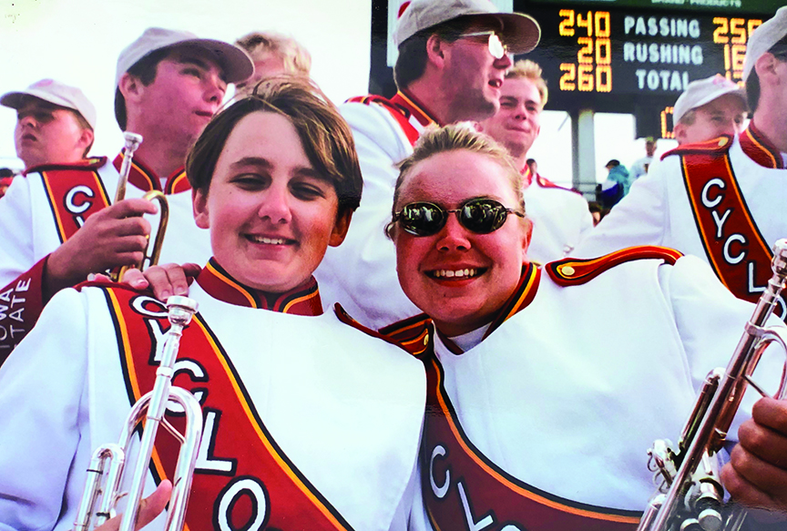 Jen Scharff as an Iowa State undergraduate, posing with marching band friends