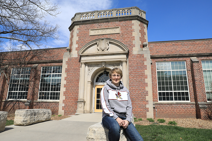 Jen Scharff poses in front of the Physics Building on the Iowa State campus