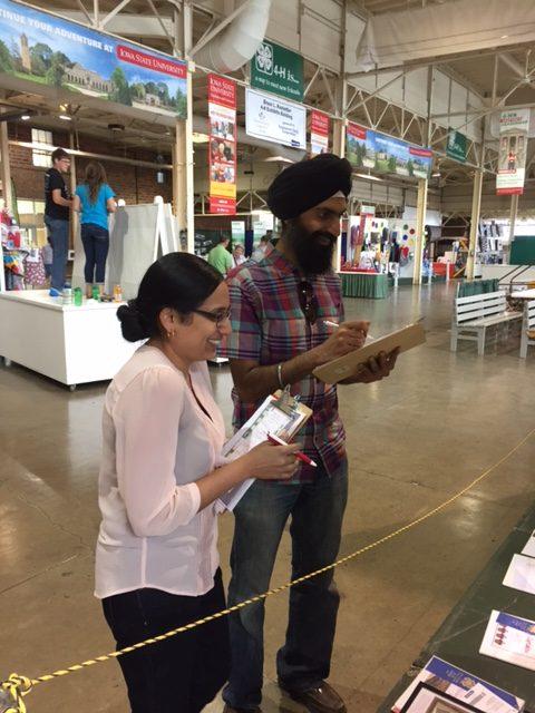 Geetu Tuteja, left, and Ranpal Dosanjh judge 4-H projects at the 2017 Iowa State Fair.