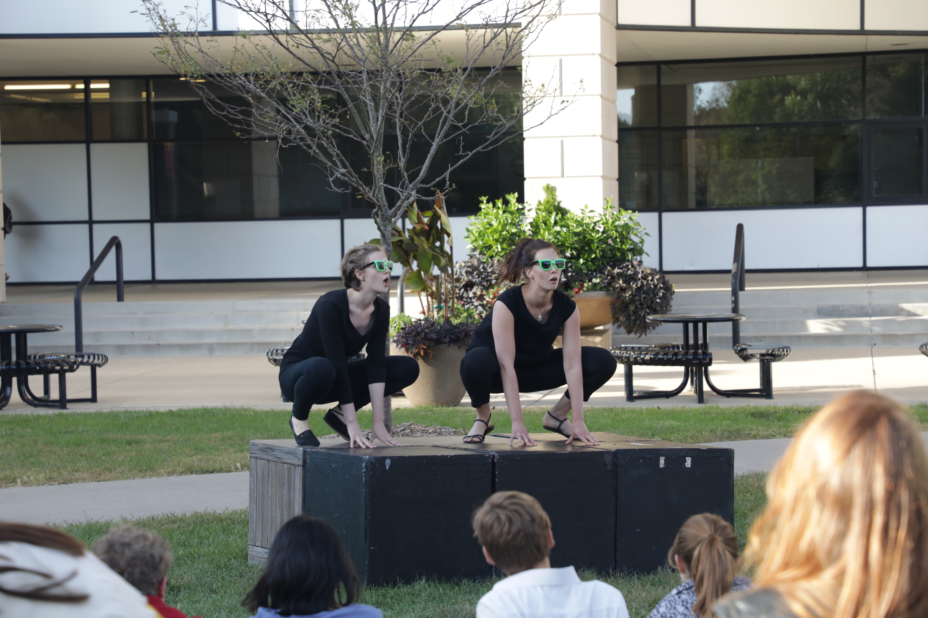 "Lena Menefee-Cook ('20 performing arts, art & design) and Emilia Ősterlind (industrial engineering graduate exchange student) perform ""Pond Life"" as part of Climate Change Theatre Action in front of Parks Library."