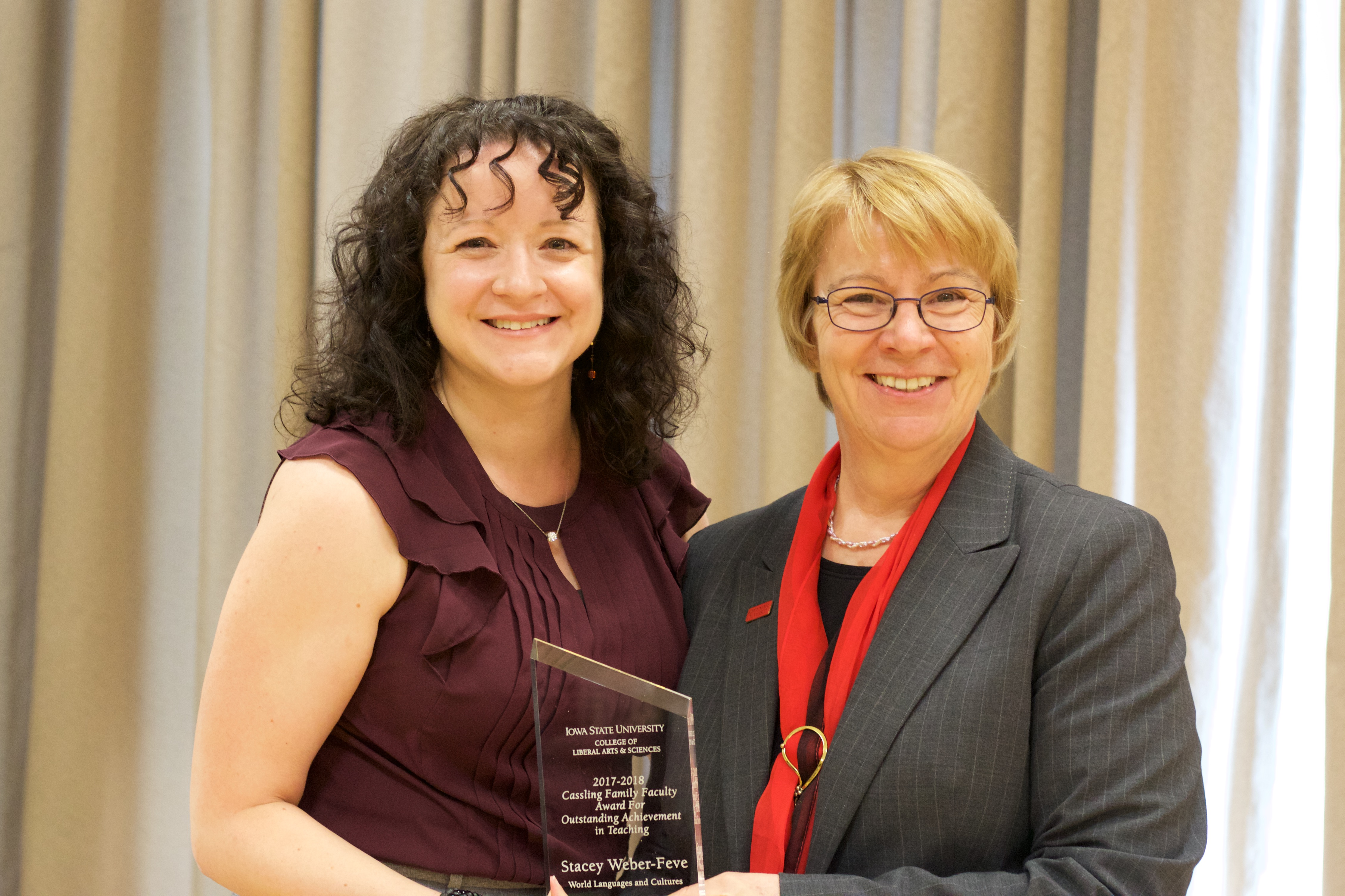 Stacey Weber-Feve, associate professor of French, receives the Cassling Award for Outstanding Teaching from Beate Schmittmann, dean of the College of Liberal Arts and Sciences.