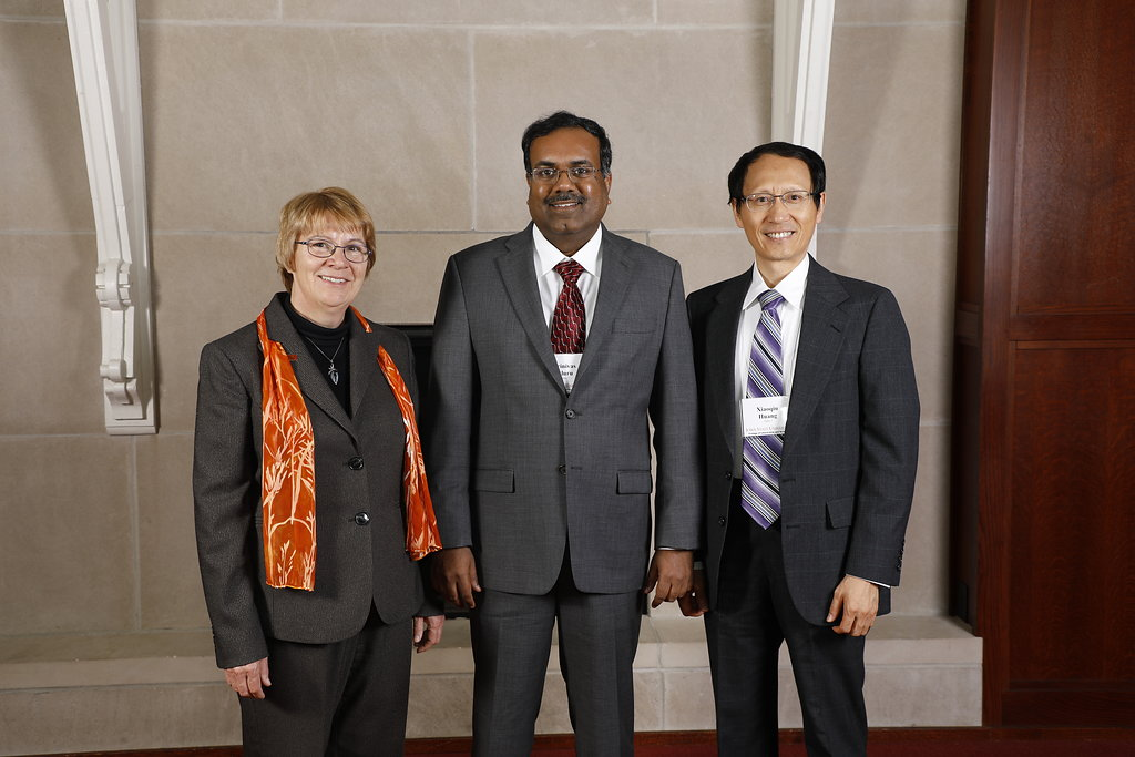 Left to right: LAS Dean Beate Schmittmann, Srinivas Aluru, recipient of the College of Liberal Arts and Sciences John V. Atanasoff Discovery Award, and Xiaoqiu Huang, professor of computer science.