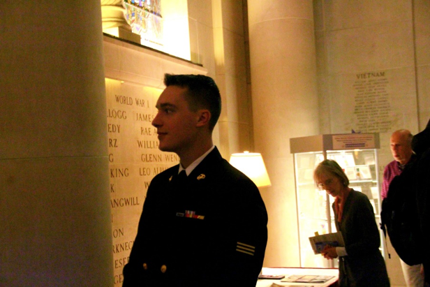 A soldier gazes upon the Gold Star Hall wall.