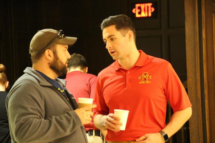 Midshipman Stenglein converses with a Navy veteran.