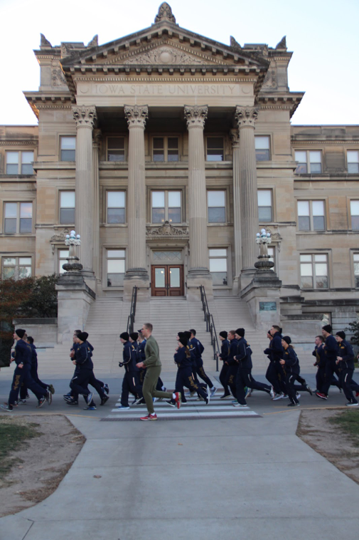 The battalion runs past Beardshear Hall.