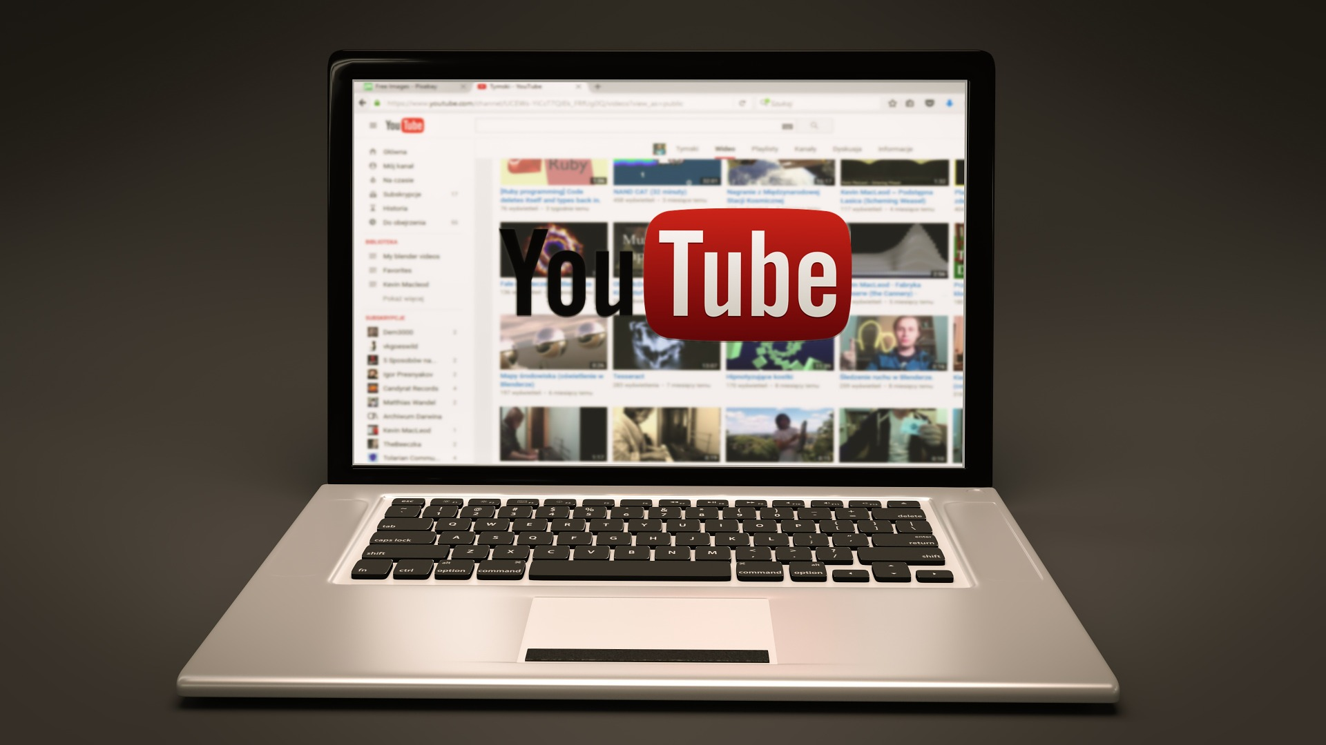 A laptop with youtube on the screen.