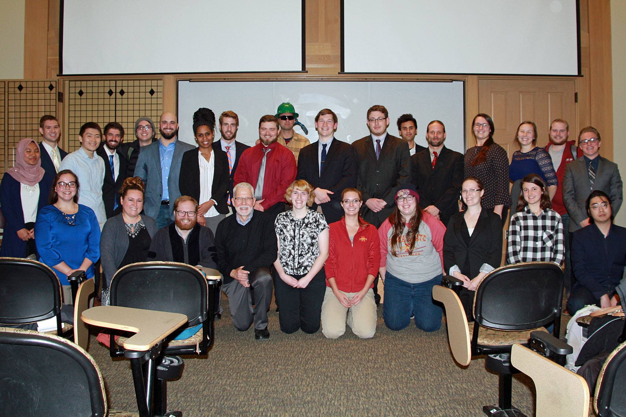 Students and faculty pose in two rows.
