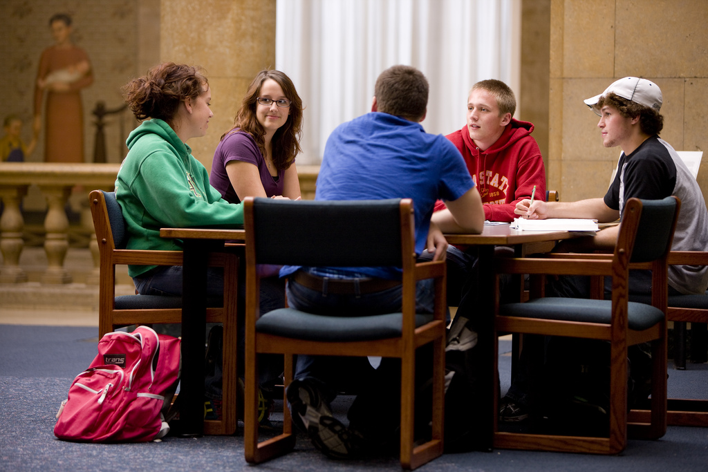 Five students studying in a library