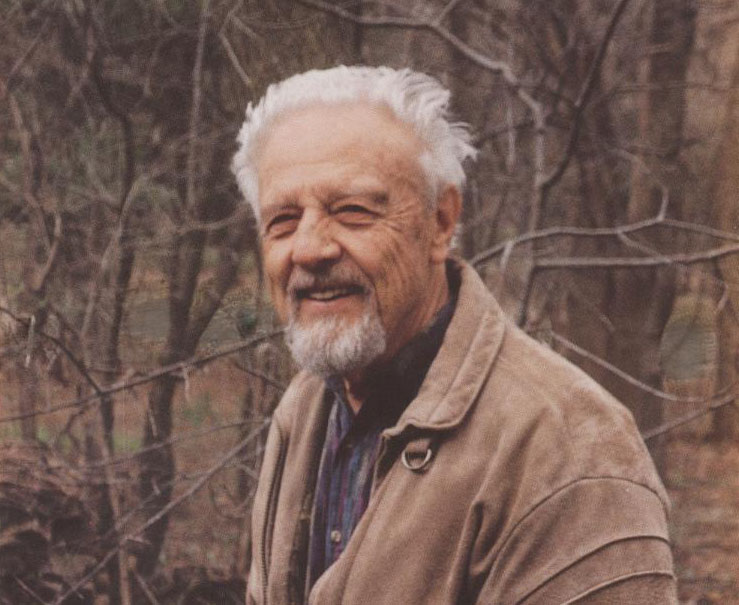 A photo of Klaus Ruedenberg outside in the woods in the fall.