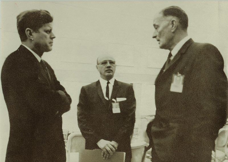a black and white photo shows Dwight with President Kennedy