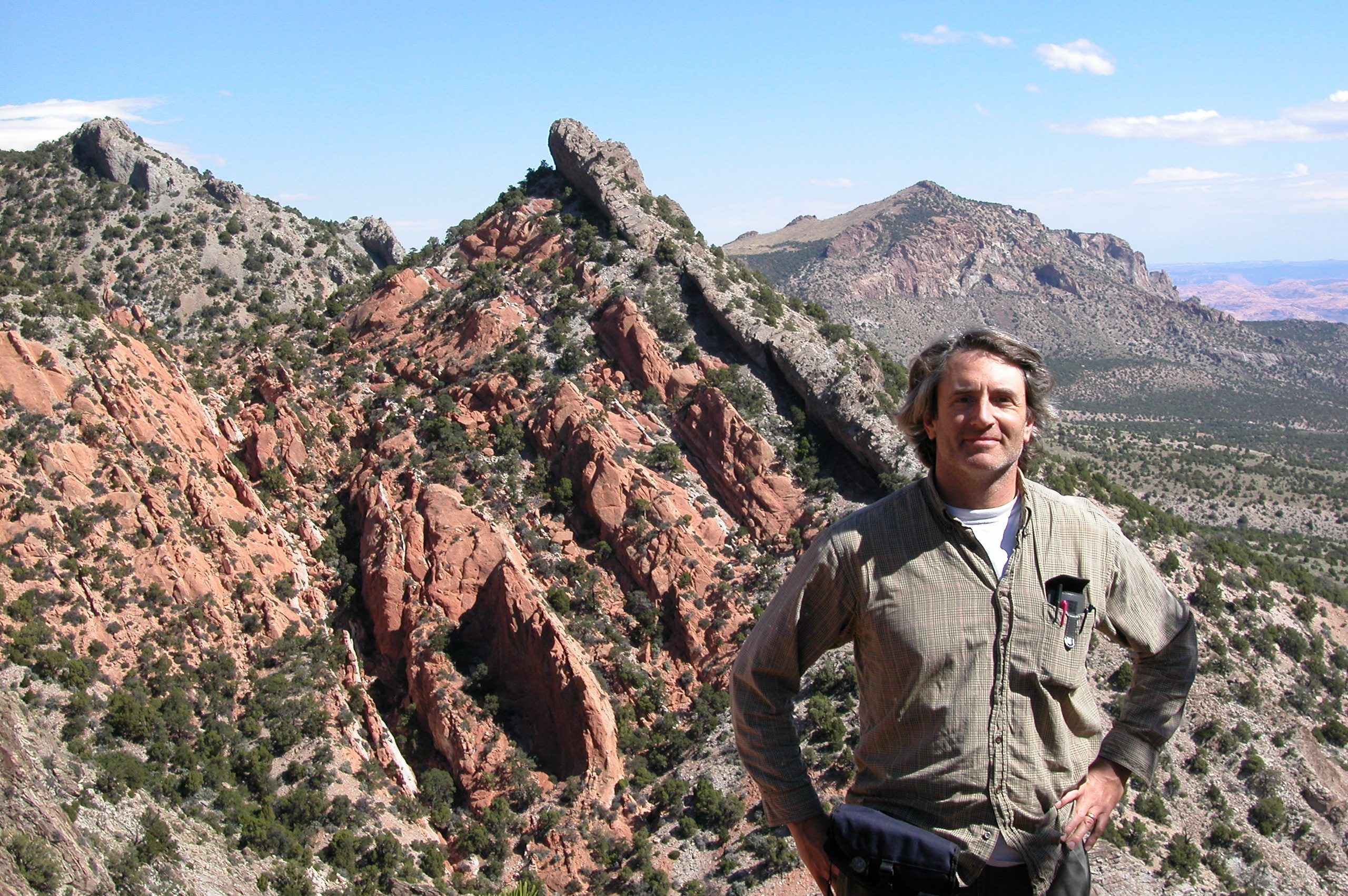 Sven Morgan in front of red rocky land.