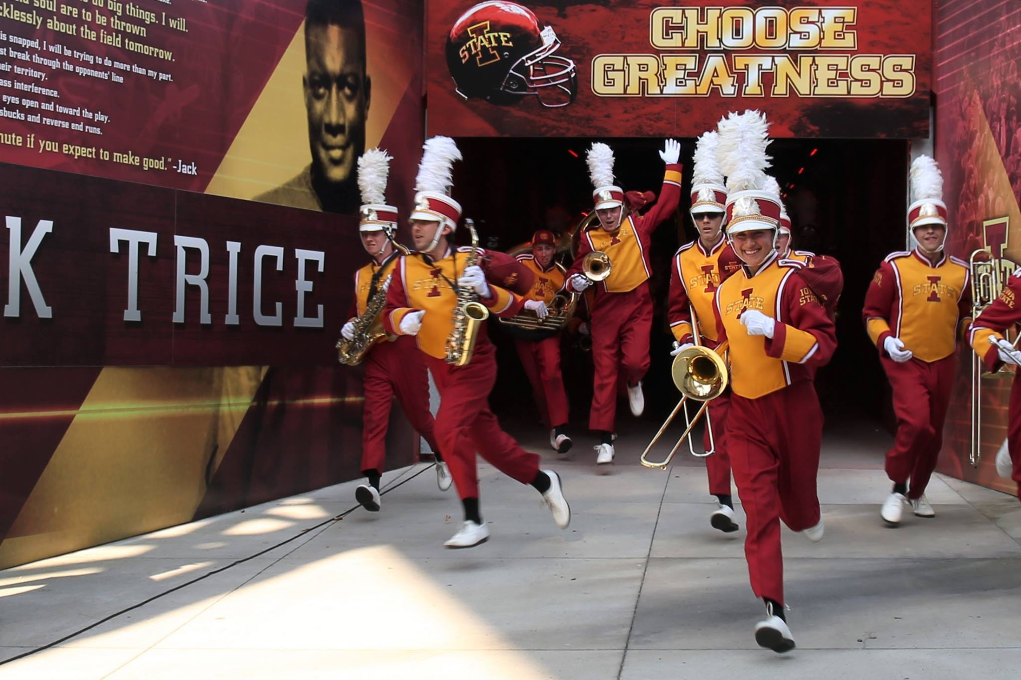 Marching band members enter the stadium.