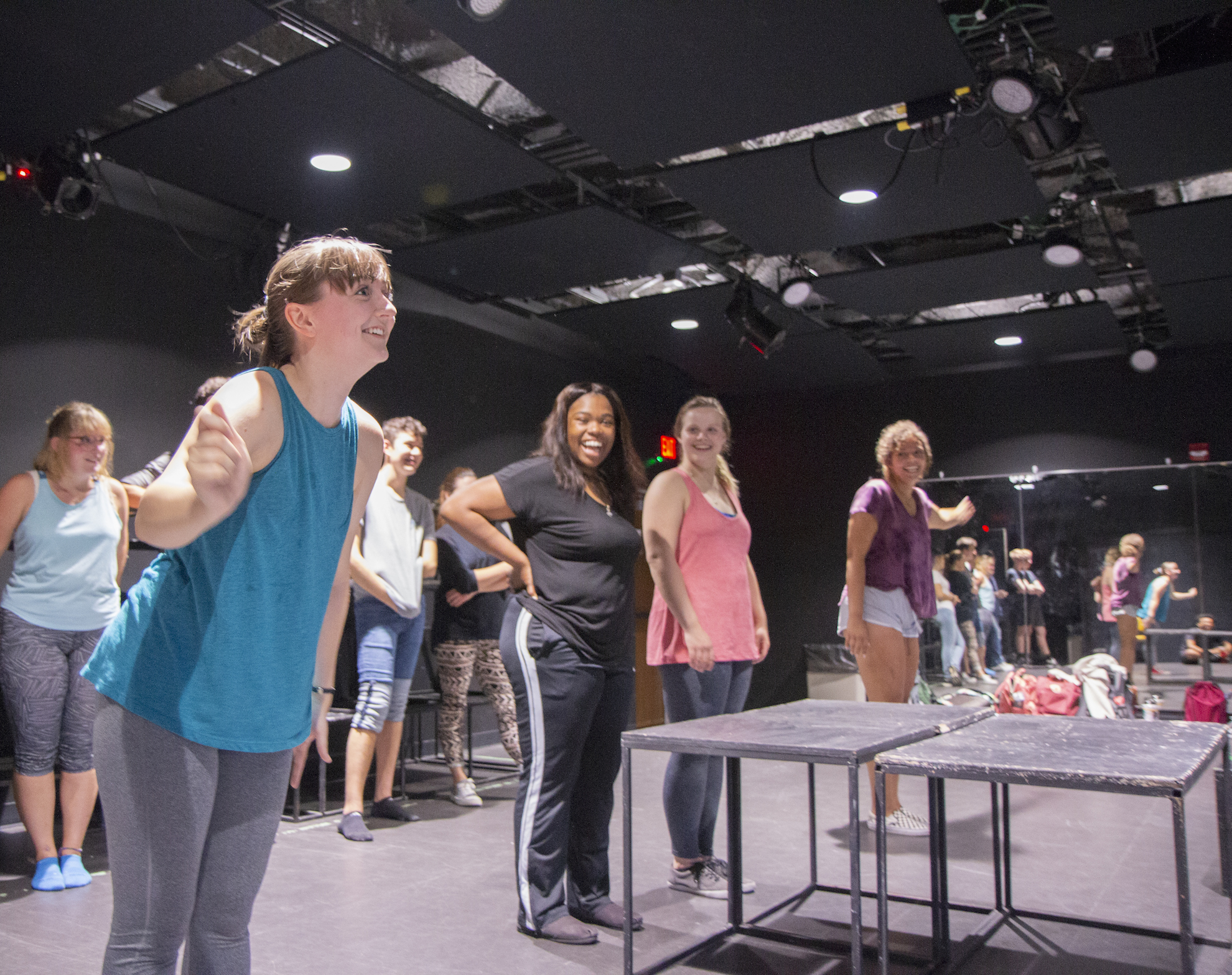A student stands in a studio rehearsing a play.