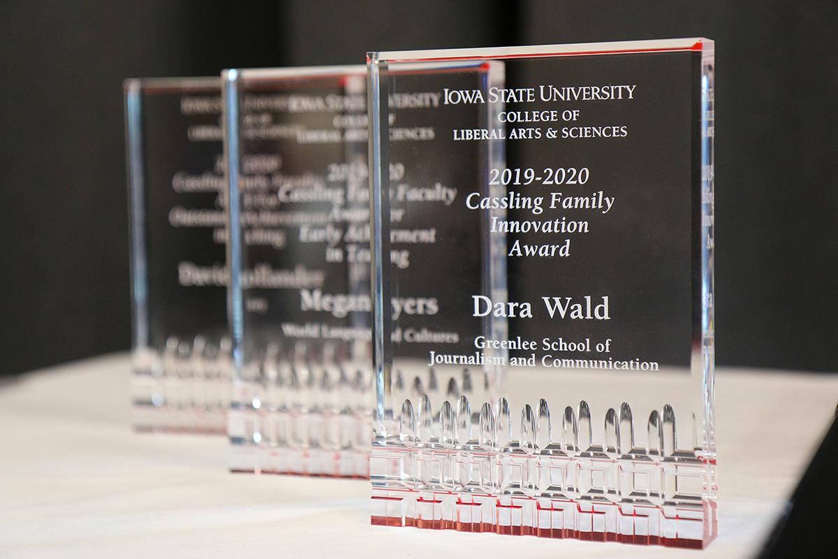 Three LAS awards on table.