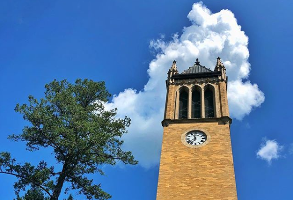 ISU Campanille in front of blue sky with clouds