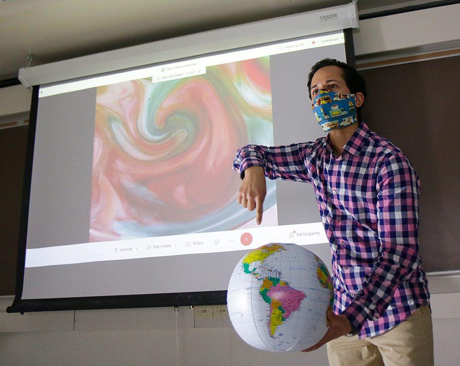 Alex Gonzalez gives a lecture about tropical weather