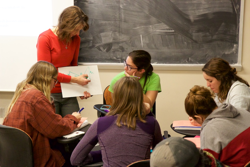 Heather Bolles works with a group of students.