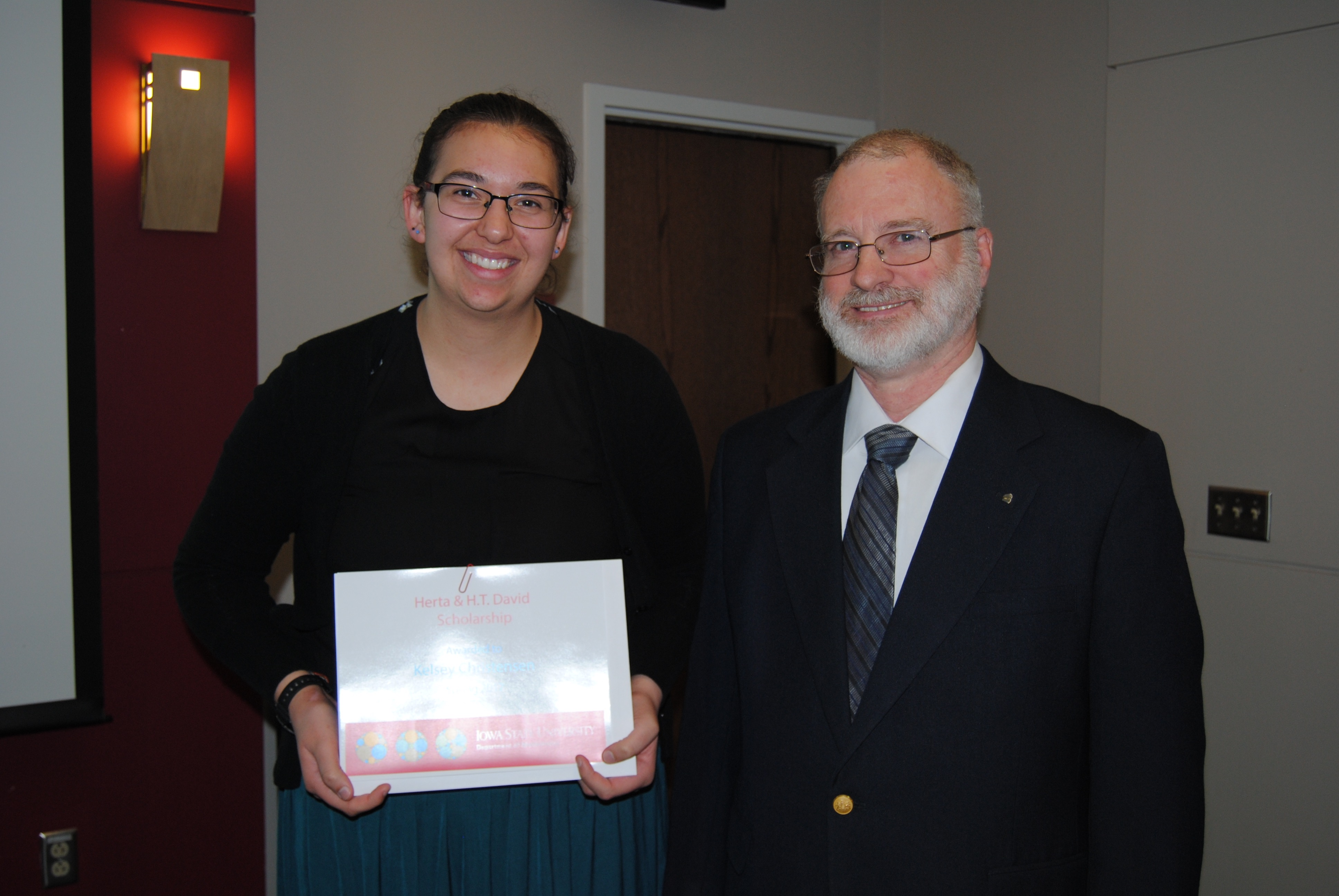 James Wilson, director of undergraduate education, presents Kelsey Christensen with the Herta & H.T. David Scholarship.