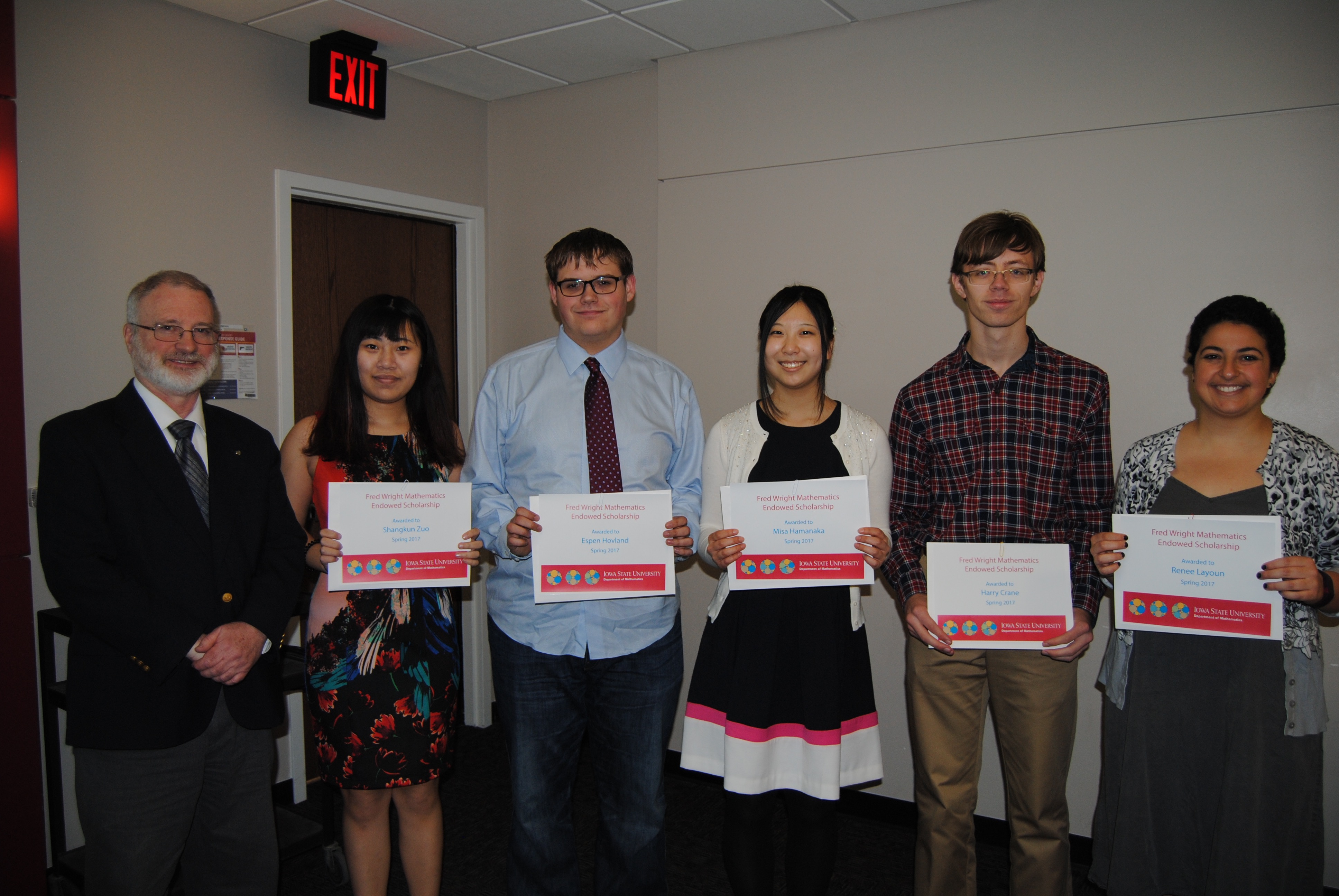 James Wilson, director of undergraduate education, presents undergraduate students Shangkun Zuo, Espen Hovland, Misa Hamanaka, Harry Crane, and Renee Layoun with Fred Wright Mathematics Scholarships.
