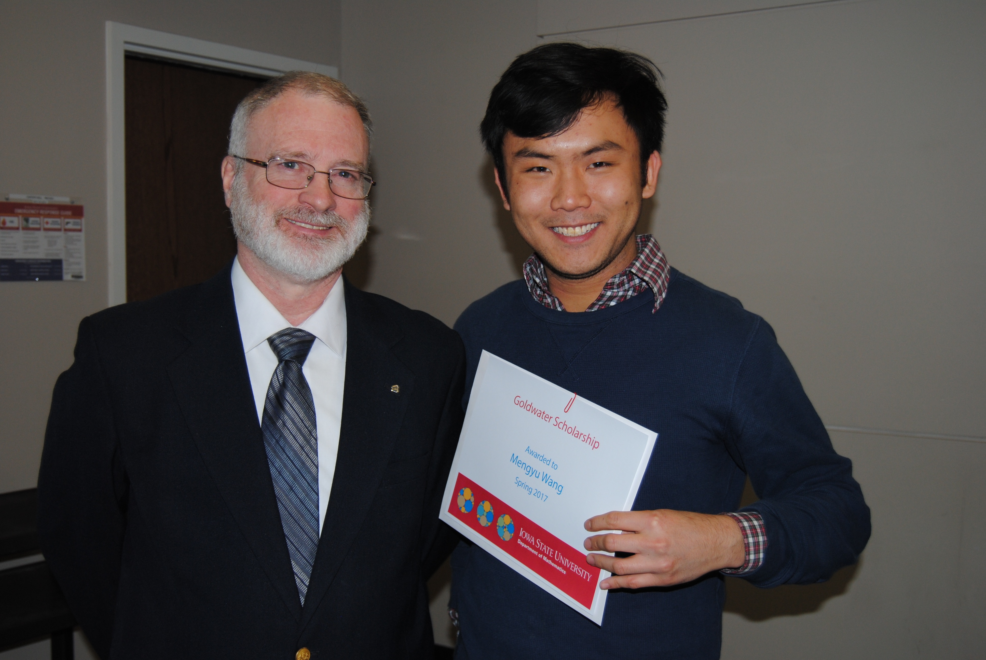 "James Wilson, director of undergraduate education, presents Mengyu ""Allen"" Wang with a certificate in recognition of receiving the Goldwater Scholarship."