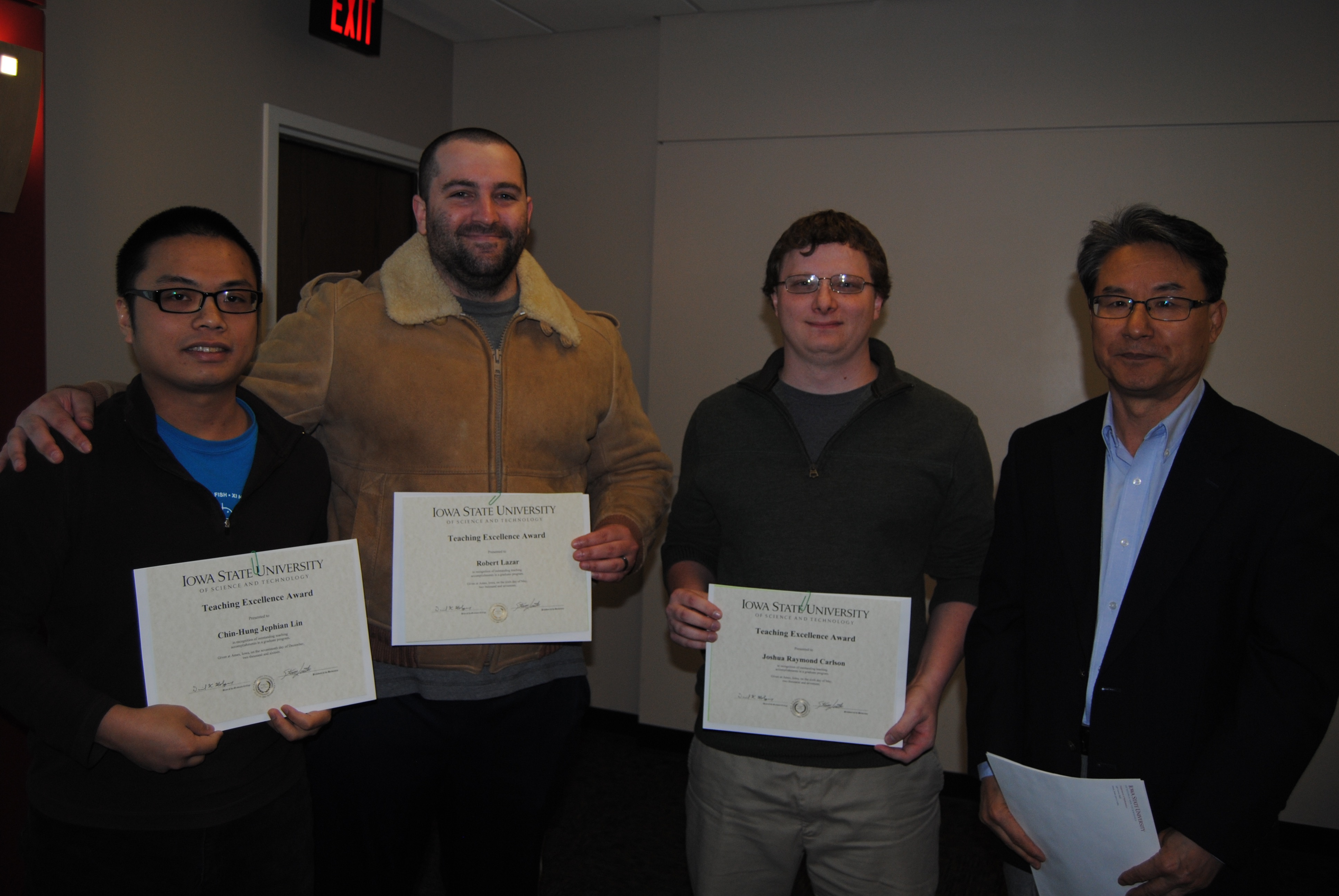 "Sung-Yell Song, associate professor of mathematics, presents graduate students: Chin-Hung ""Jephian"" Lin, Robert Lazar, and Joshua Carlson with certificates for the ISU Teaching Excellence Award."