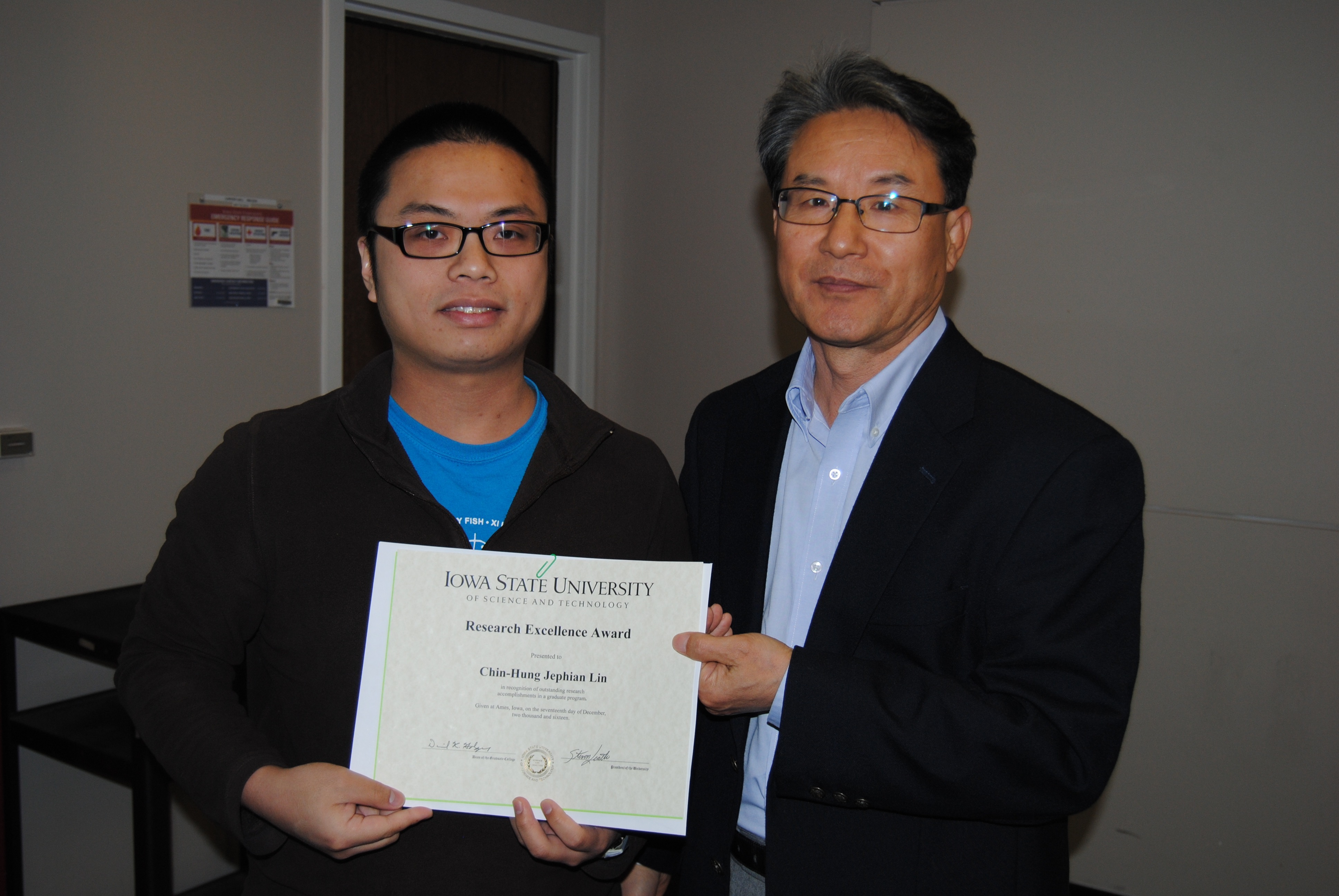 "Sung-Yell Song, associate professor of mathematics, presents graduate student Chin-Hung ""Jephian"" Lin with the ISU Research Excellence Award."